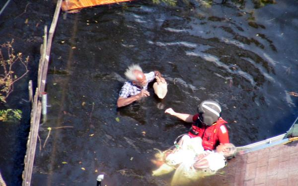 image of rescue swimmer in flood waters in New Orleans